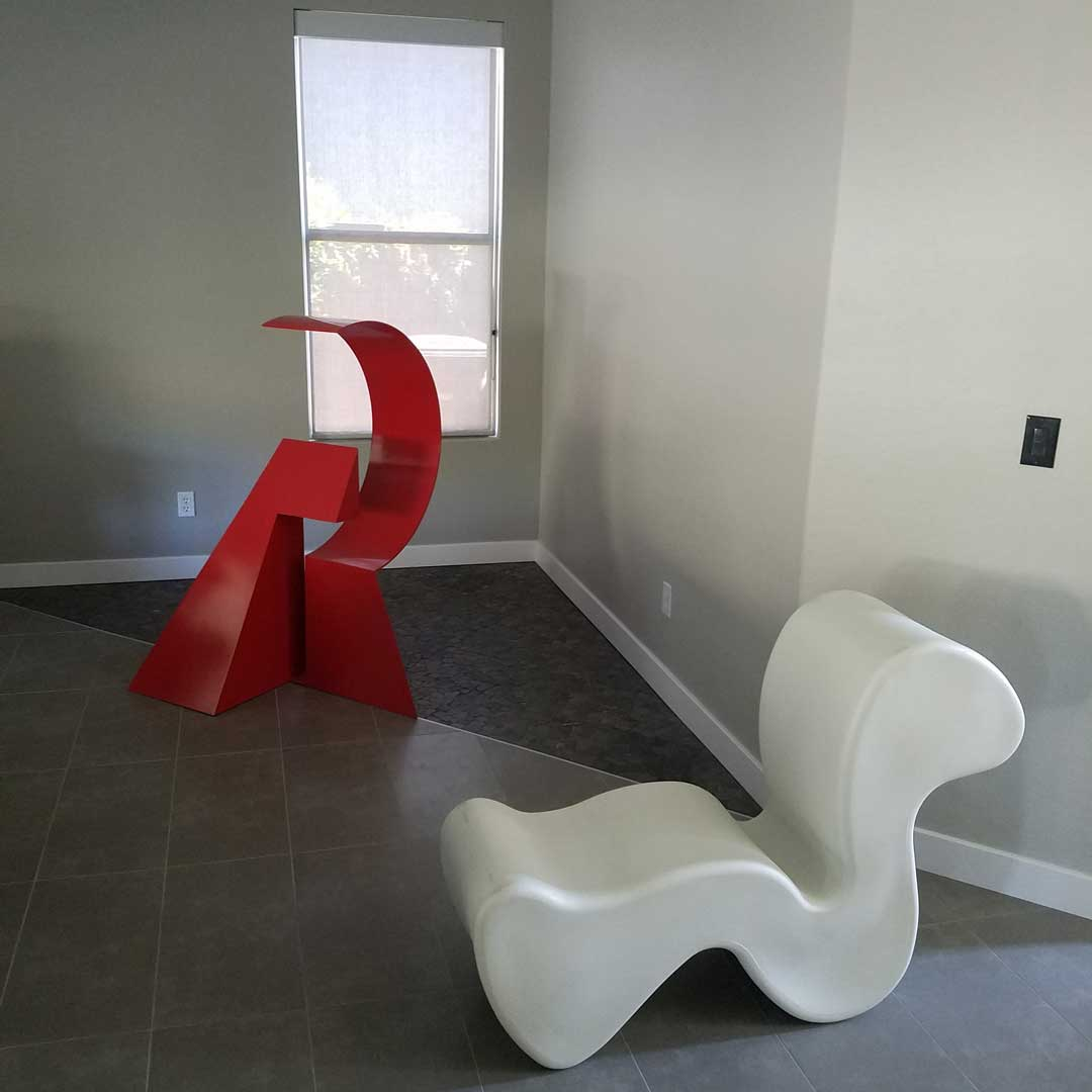 red-scultpure-living-room